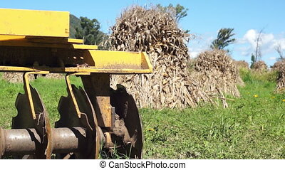 Disc Harrow Corn Piles Dolly - Dolly shot with close up...