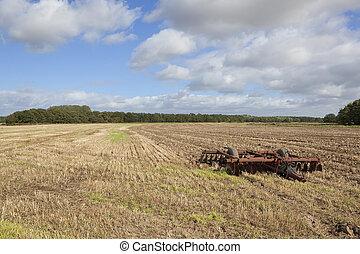 disc harrows in a stubble field