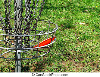 Disc In the Basket - A fariway disc that has landed in a ...