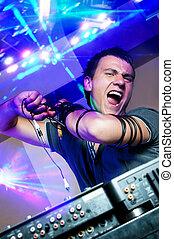 Disc Jockey - Disc jockey with electronic mixer and mixing ...
