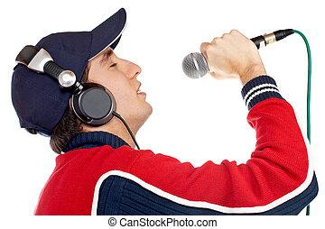 Disc jockey singing - Disc jockey with headphones singing on...