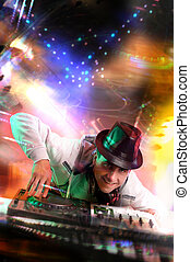Disc Jockey - Disc jockey work with electronic mixer and...
