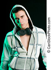 Disc Jockey - Portrait of DJ with headphones at night club