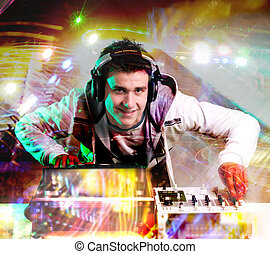 Disc Jockey - Disc jockey wearning hedphones and mixing...