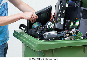 Putting used and old computer hardware into the dustbin.