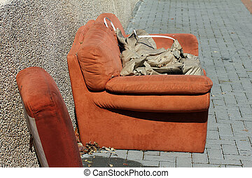 Discarded old sofa