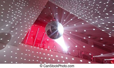 Disco ball at the New Year party, people having fun in the background