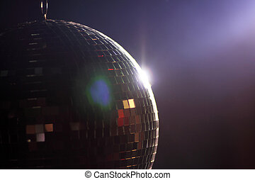 Disco ball - Ray of light hitting a disco ball.