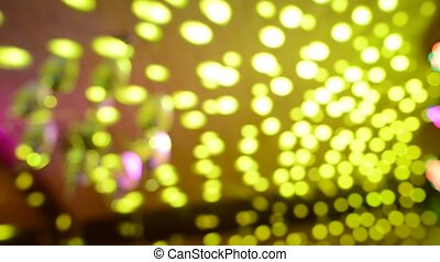 Disco Ball, view from below, from the disco ball beams, stage light, abstract blurred video