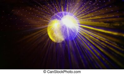 Disco ball with bright rays from the ceiling shines at the party. Slow motion. 1920x1080