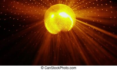 Disco ball with bright rays rotates on ceiling shines at the party in Slow motion. 1920x1080