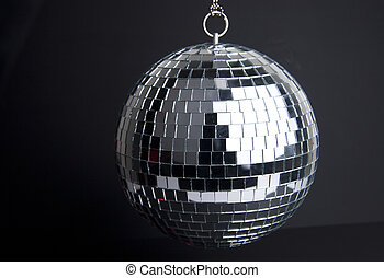 disco ball with small mirrors on dark background