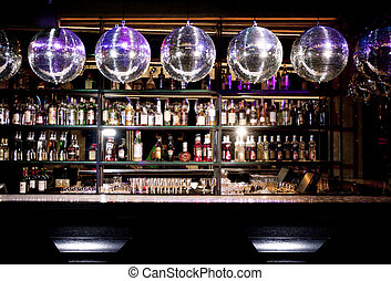 Disco bar counter with bottles in blurred background