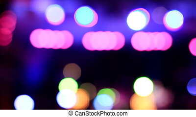 Disco blue, pink, orange lights out of focus. Abstract bokeh.