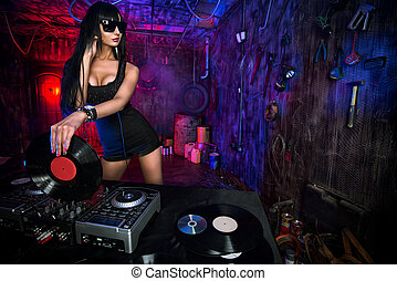 disco club - Beautiful sexy DJ girl working on a party in...