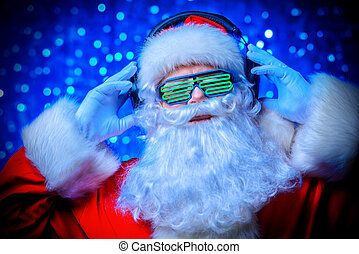 disco in xmas night - DJ Santa Claus in luminous glasses and...