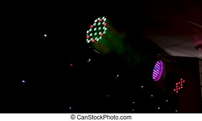 Disco lights and show. Concept about entertainment and party. Balloons and smoke