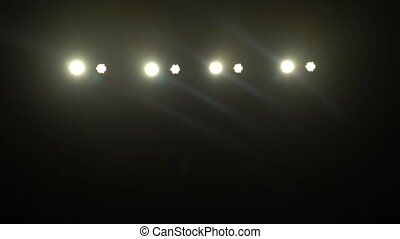 Disco lights glow in the distance - Disco lanterns glow in...