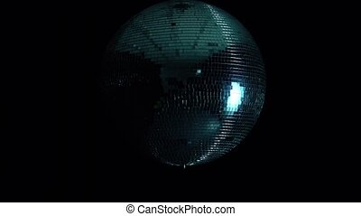 Disco mirror ball at black background with glares