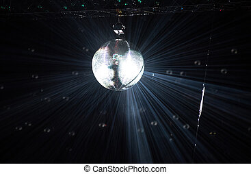 Disco mirror ball hanging at a retro party