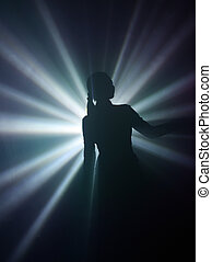 Disco - Silhouette of dancing girl in rays of light