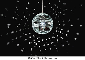 discoball - spinning discoball, over black background, light...