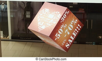 Discount 50, 75 percent, sign on the cube