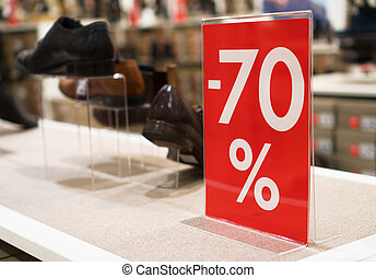 Discounts in the shopping center. 70 percent discount.