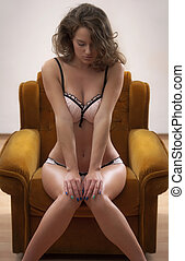 Discover sensuality. - Gorgeous slender young woman wearing...