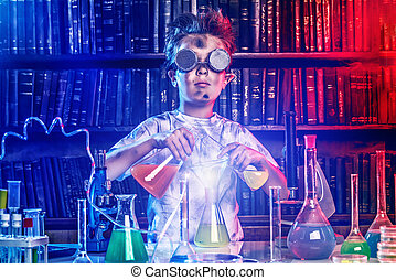 discovery - A boy doing experiments in the laboratory. ...