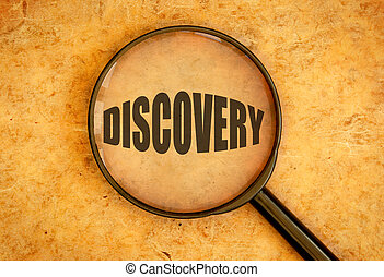 Magnifying glass focused on the word discovery