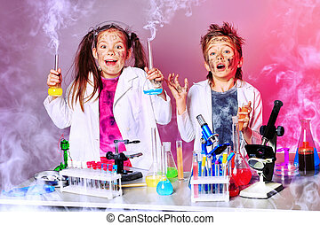 discovery - Two children making science experiments....