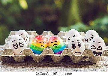discrimination gay concept. Two rainbow eggs in the form of a homosexual couple. And condemning people around