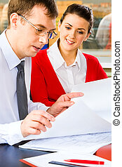 Discussing - A young promising business lady looking at the ...