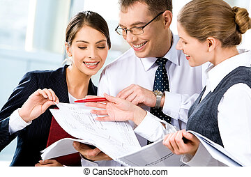 Discussing business plan - Image of three happy business...
