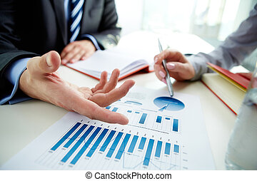 Discussing chart - Image of male hand pointing at business ...