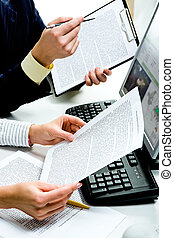Discussing documents - Close-up of businesspeople�s hands ...