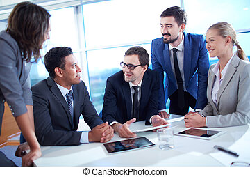 Discussing ideas - Group of business partners discussing...