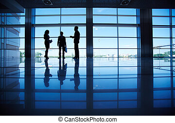Discussing ideas - Silhouettes of several office workers...