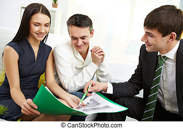 Discussing mortgage conditions - Portrait of modern couple...
