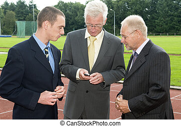 Discussing On A Racetrack