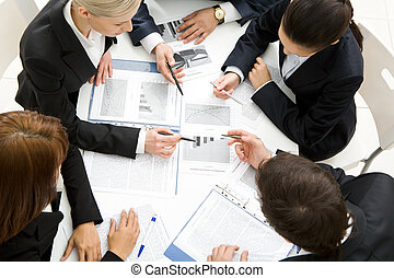 Discussing plan - Above view of successful workteam ...