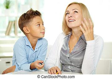 Discussing plot - Portrait of pretty tutor sharing her idea...