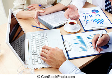 Discussing results - Overview of business team discussing ...