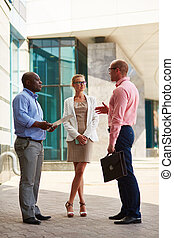 Discussing strategy - Business team having conversation in...