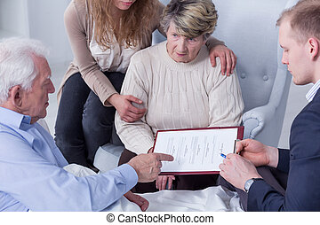 Discussing the details of the senior man's last will