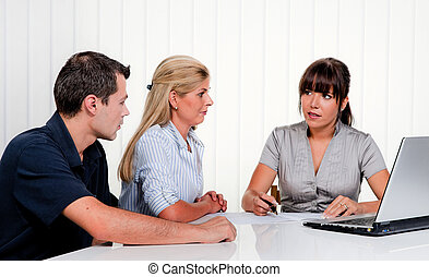Discussion at a consultation - Husband and wife in a ...