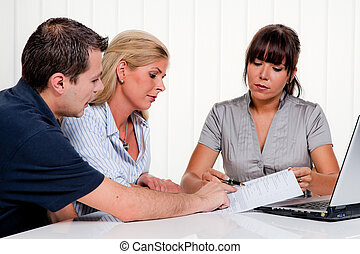 discussion at a consultation - husband and wife in a...