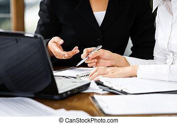 Discussion between women in office