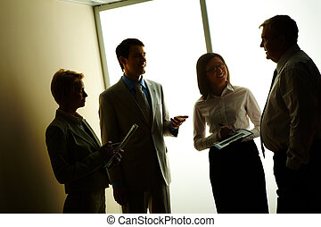 Discussion - Portrait of business partners discussing or...